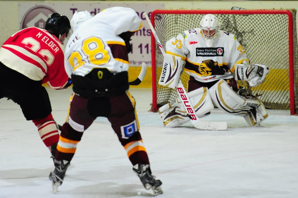 Dan Pye and Richie Lawson ensure Stars' Michael Elder's shot stays out of the net.