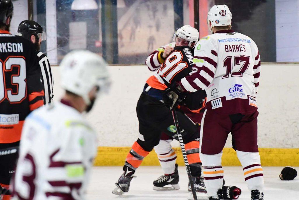Sam Zajac deals with Andrew McKinney