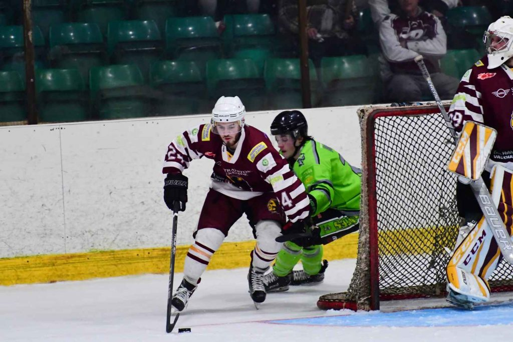 Harry Harley carries the puck from behind the net