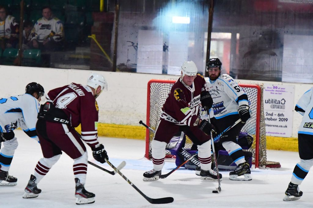David Longstaff protects the puck