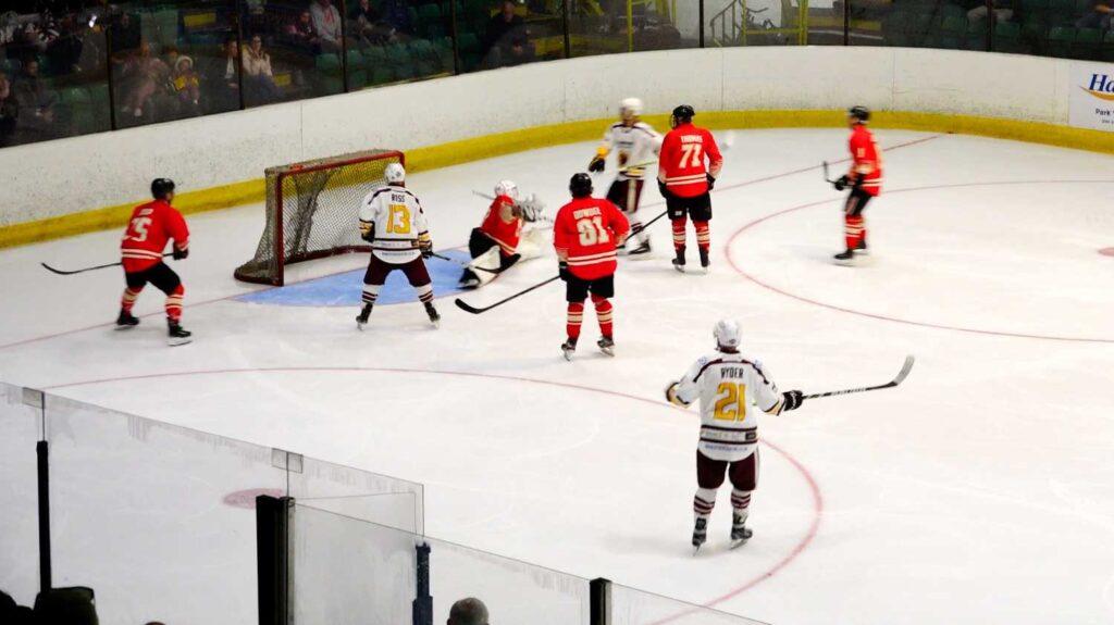 The Warriors put pressure on Billingham's net. Photo by Pyro-Media.
